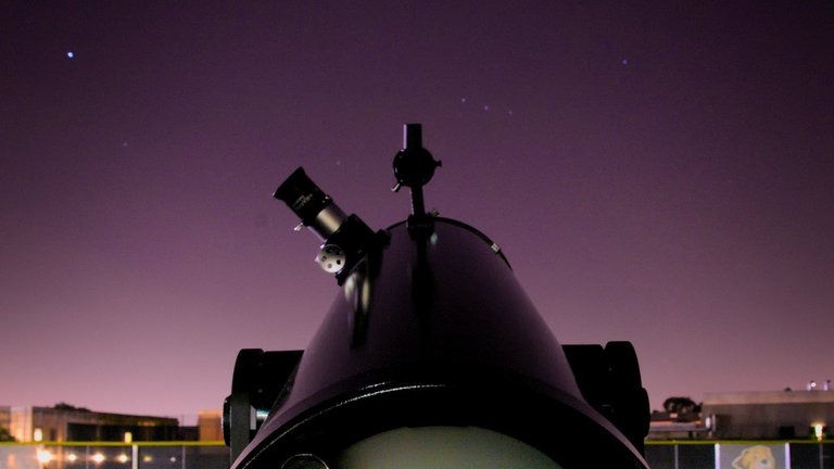A telescope set up on the athletic fields in preparation for a night of stargazing after the lecture.