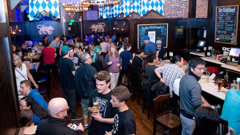 An intermission period between talks at Astronomy on Tap where scientists mingle with members of the public.