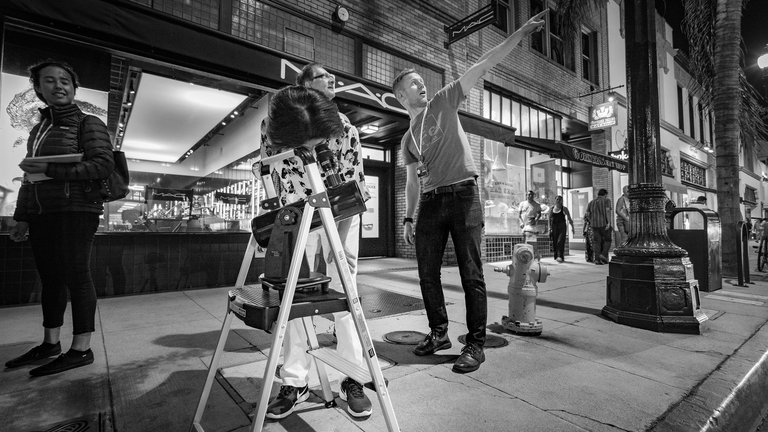 Cameron Hummels points out the location of Saturn in the sky at one of our Sidewalk Stargazing sessions.