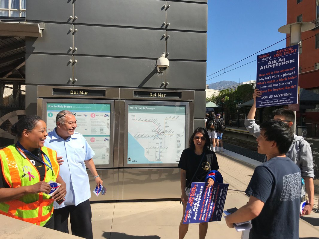 Scientists from Caltech discuss science with transit workers during a Science Train activity.