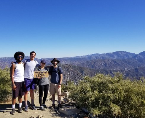 Graduate students Evan Nuñez, Max Goldberg, Samantha Wu, and Henry Peterson on a hike.
