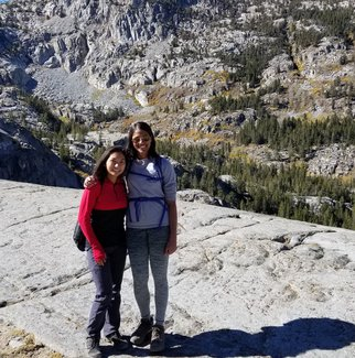 Graduate students Mia de los Reyes and Nitika Yadlapalli on a hike in the Sierra Nevada.