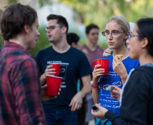 Graduate student Kathryn Plant talking with other students and faculty at the departmental beginning-of-the-year BBQ.