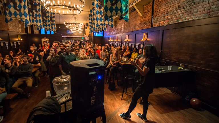 Mia de los Reyes wows the audience during her Astronomy on Tap talk about galaxy evolution.