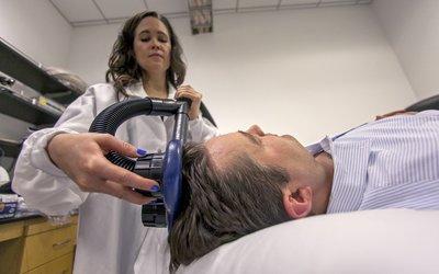 Woman scanning man's brain waves