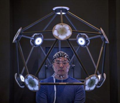 man sitting in brain scanning machine