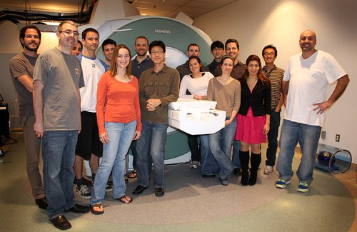 group photo in front of MRI machine