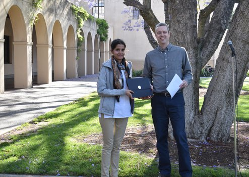 Swati Chaudhary receiving the Kar Award from Option Rep, Ryan Patterson