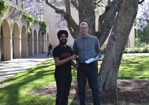 Ashmeet Singh receiving the 2019 Stewart Prize from Option Rep Ryan Patterson