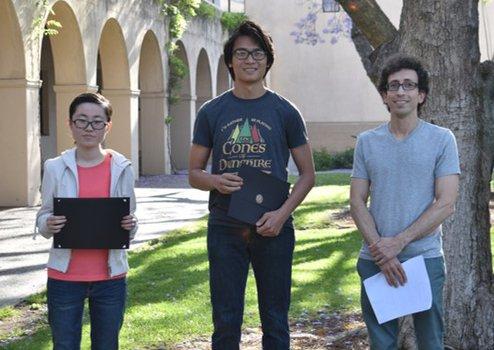 Xiaoling Liu and Daniel Mark (2019 Winners) with Undergraduate Option Representative Jason Alicea