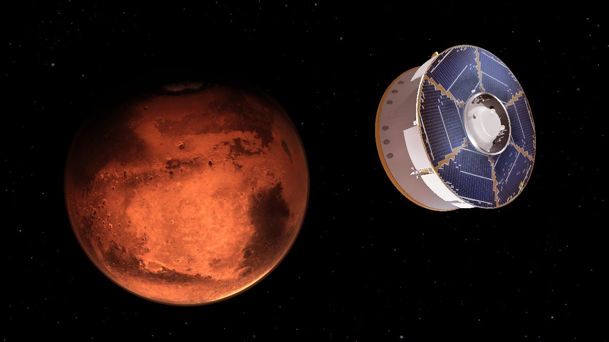 Artist's rendering of a spacecraft with blue solar panels approaching Mars in space.