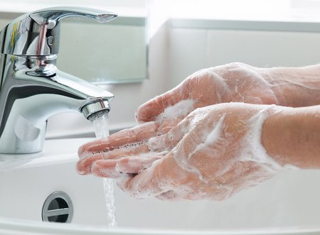 Photo of hand washing.