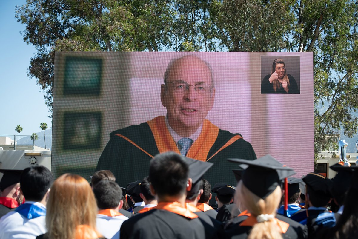 Commencement speaker Norman R. Augustine on a video screen