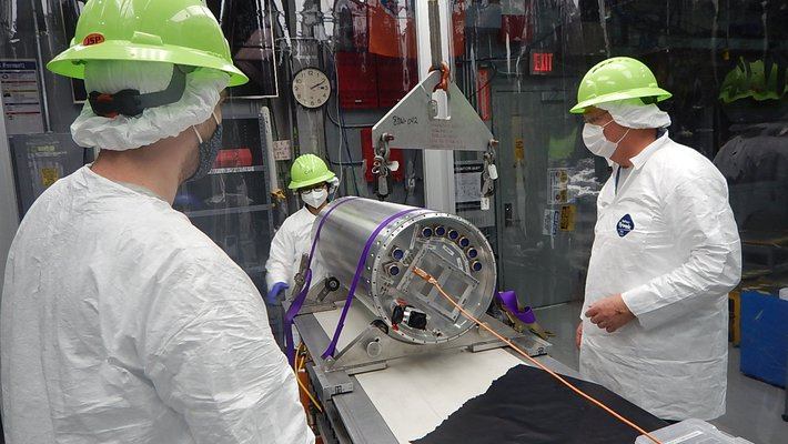 Richard Feder-Staehle, Chi Nguyen, and Rick Evavold of the CIBER-2 team working on the CIBER-2 payload.