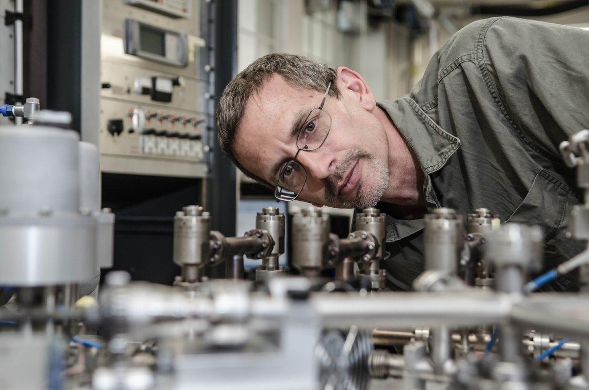 Ken Farley looking at mechanical apparatus