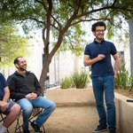 Joshua Frisch, Omer Tamuz, and Pooya Vahidi Ferdowsi discuss a math problem at Caltech.
