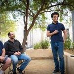 Joshua Frisch, Omer Tamuz, and Pooya Vahidi Ferdowsi discuss a math problem at Caltech.
