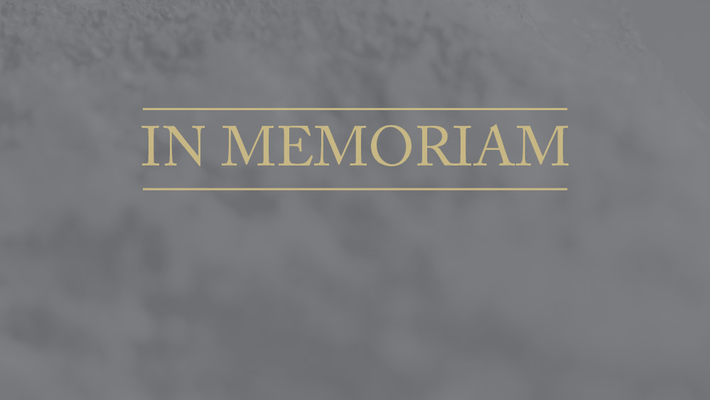 image with the word in memoriam on a grey background