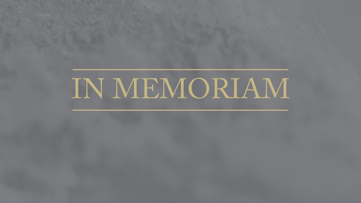 """image of the words """"In Memoriam"""" on a gray background"""