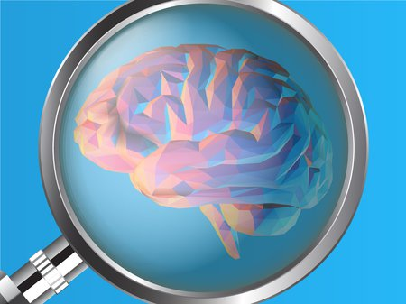 A magnifying glass examines a computer-generated brain