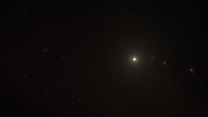 Artwork of the HR 8799 system showing a white star and four red planets.