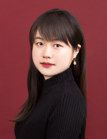Portrait of Seo-young Silvia Kim in a black turtleneck on a red background