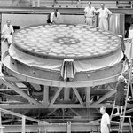 Workers pose with a 200-inch mirror, under construction for Palomar Observatory