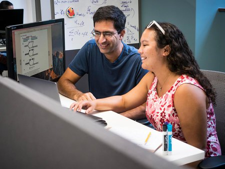 Graduate student Rebekah Loving with Bren Professor of Computational Biology and Computing and Mathematical Sciences Lior Pachter
