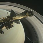 artist's concept of Cassini spacecraft hovering above Saturn's northern hemisphere