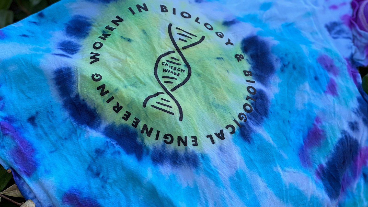 a blue tie dye t-shirt with the logo for women in BBE